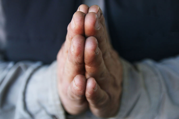 Close-up of hands praying
