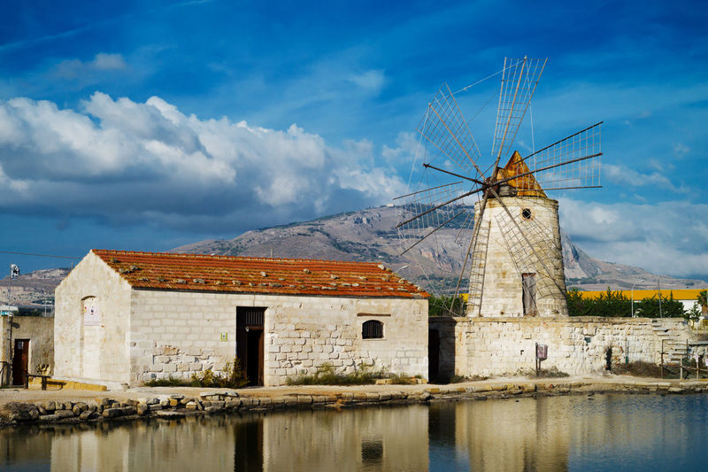 Architecture Cloud - Sky Day Mill Nature No People Old-fashioned Outdoors Sky Traditional Windmill Travel Water Windmill