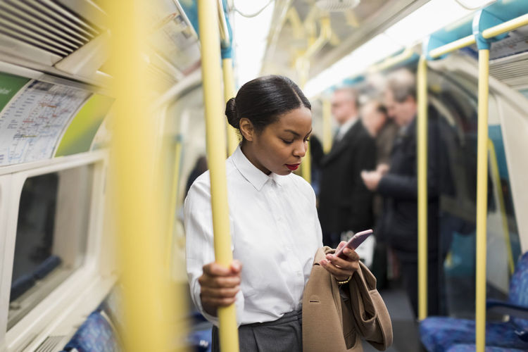 Full length of woman looking at train