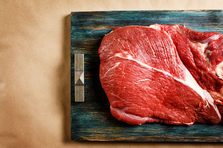 High angle view of meat on cutting board