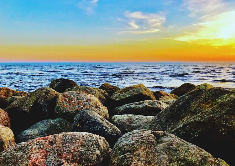 Beach Water Sea Sky Beach Horizon Over Water Scenics - Nature Horizon Land Nature Rock Sunset Cloud - Sky Beauty In Nature Tranquility Rock - Object Tranquil Scene Sunlight Solid Outdoors Idyllic