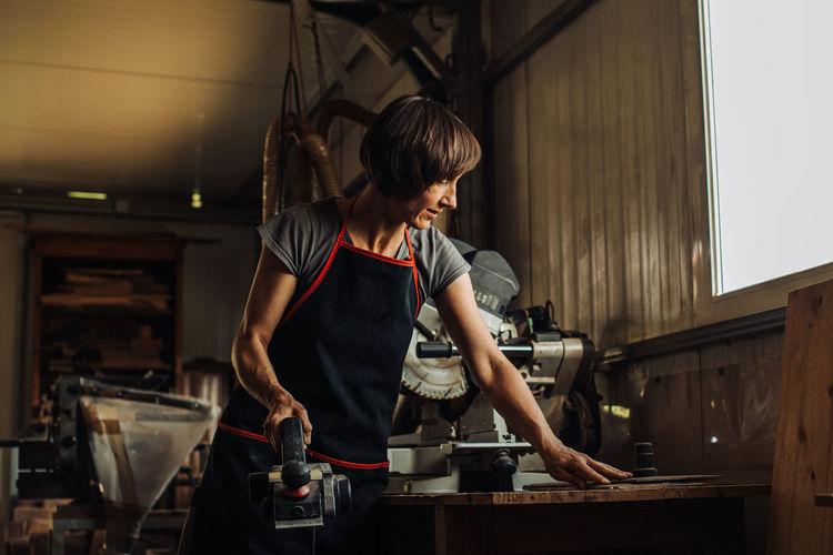Woman working on cutting board