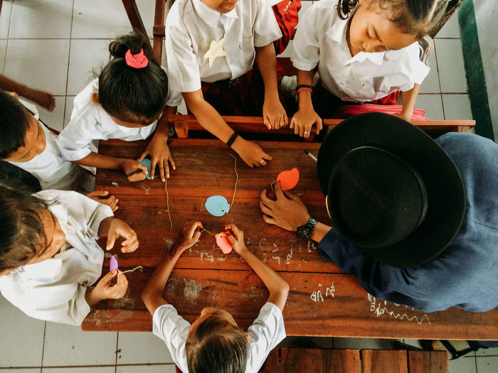 High angle view of children playing at table