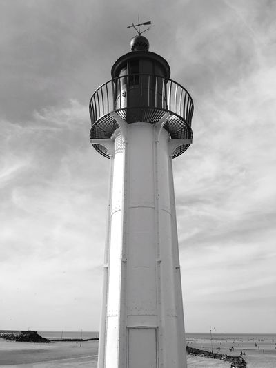 Low Angle View Of Lighthouse On Shore Against Sky
