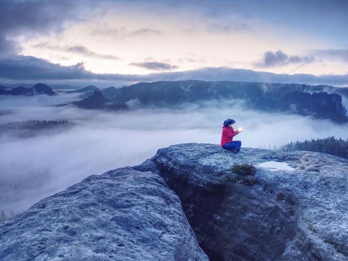 Man on rocks against mountain