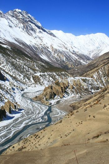Electricity slowly creeping up the Annapurna Circuit in Nepal Beauty In Nature Clear Sky Cold Temperature Himalaya Landscape Mountain Mountain Range Nature Nepal Non-urban Scene River Snow Snowcapped Mountain The Natural World Tranquil Scene Tranquility Travel Travel Destinations Winter