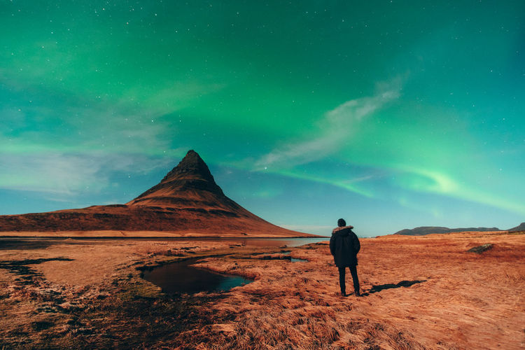 Northern Lights Aurora Kirkjufell Beauty In Nature Sky Scenics - Nature Real People Rear View One Person Tranquility Non-urban Scene Tranquil Scene Leisure Activity Space Standing Lifestyles Cloud - Sky Nature Mountain Idyllic Landscape Environment Astronomy Aurora Borealis Aurora Polaris