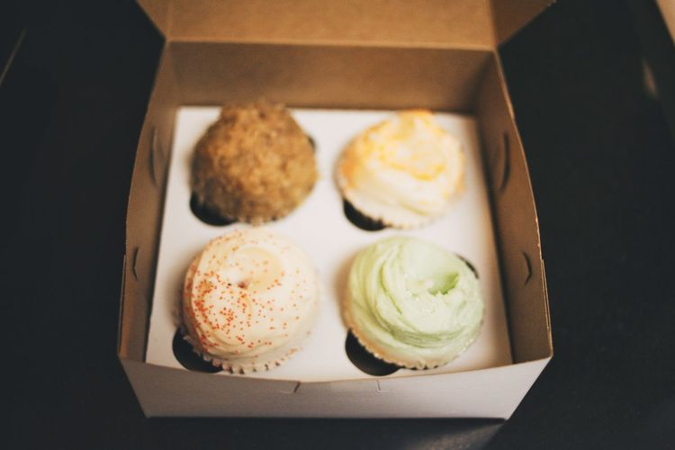 Close-up of cupcakes in cardboard box
