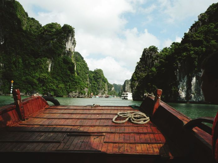 Scenic View Of Halong Bay Against Cloudy Sky