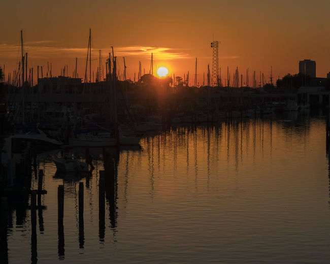 A beautiful sunset at a marina in New Orleans over Lake Pochartrain. So grateful to have captured this! Sunset Water Sky Reflection Nautical Vessel Waterfront Orange Color Harbor Silhouette Beauty In Nature Nature Outdoors Marina Mode Of Transportation No People