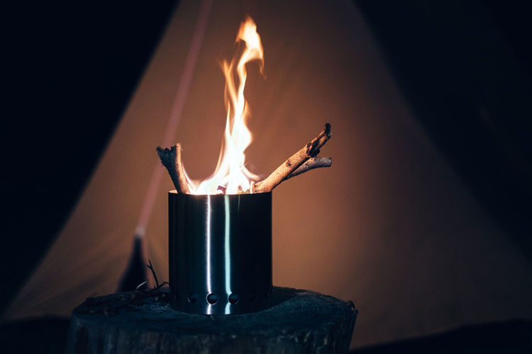 Camping Hiking Rustic Appliance Burning Camping Stove Candle Close-up Fire Fire - Natural Phenomenon Flame Food And Drink Glow Glowing Heat - Temperature Illuminated Indoors  Nature Night No People Sign Sticks Stove Tent Warm