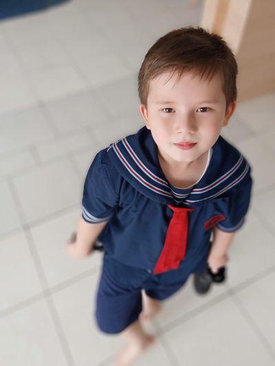 High angle portrait of cute boy wearing uniform