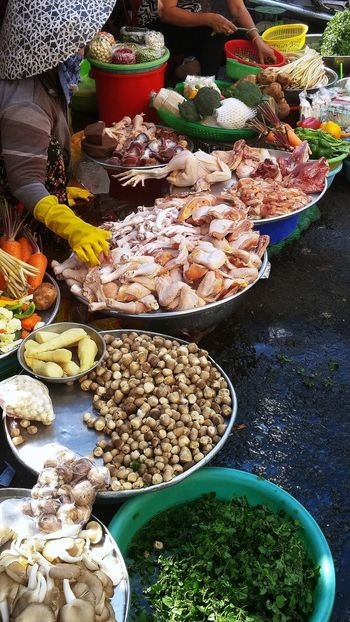 Not Your Local Market [SP] ~ Food Stories Abundance Buyers And Sellers Choice Day Food Food And Drink For Sale Fresh Food Freshness Healthy Eating High Angle View Large Group Of Objects Market Market Stall One Person Outdoors People Real People Retail  The Street Photographer - 2017 EyeEm Awards Variation Visual Feast