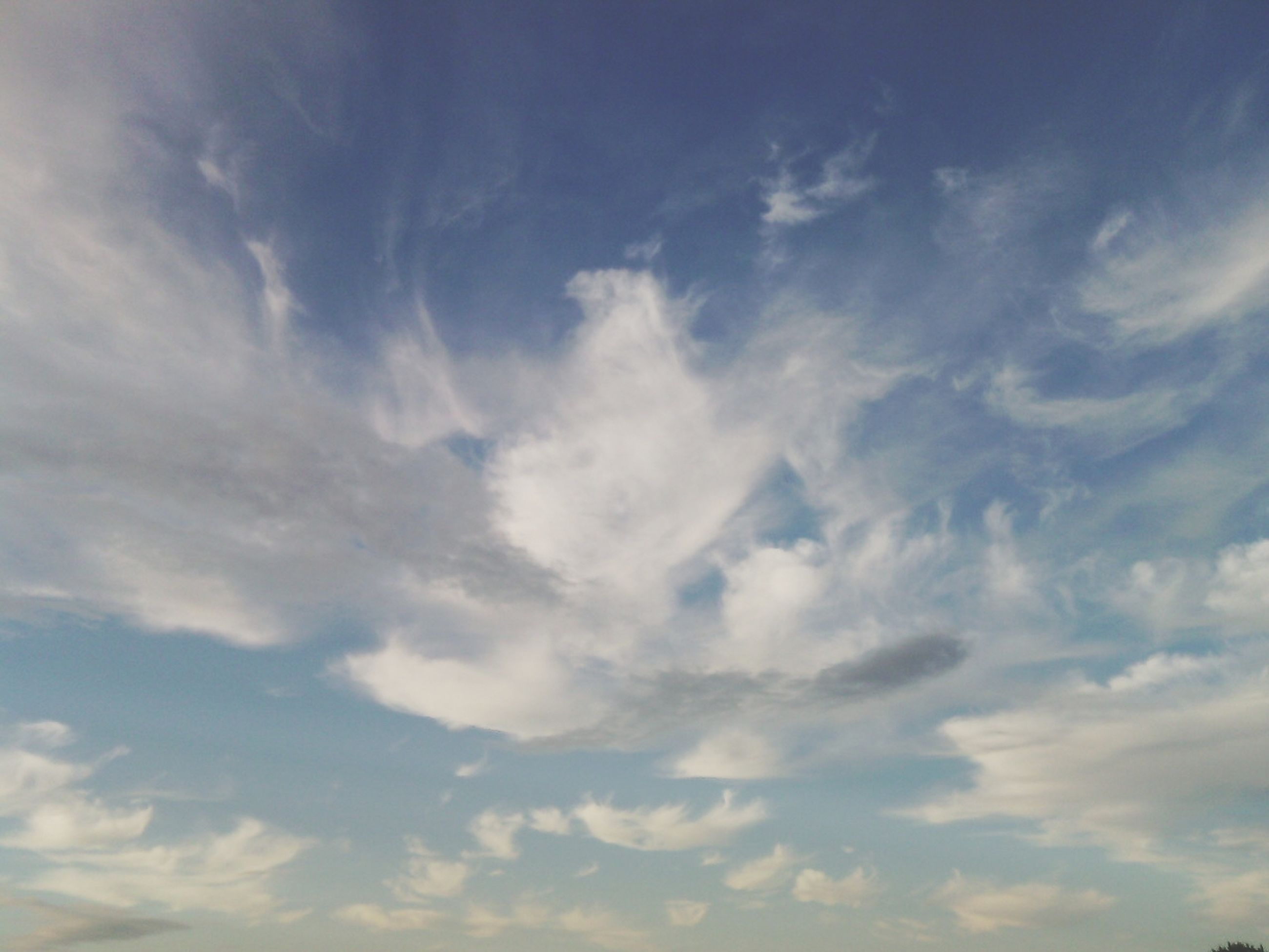 sky, cloud - sky, tranquility, beauty in nature, scenics, low angle view, sky only, tranquil scene, cloudy, nature, backgrounds, cloudscape, full frame, cloud, idyllic, outdoors, blue, no people, day, weather