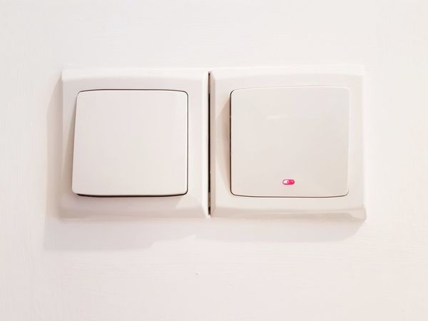 EyeEm Selects Business Finance And Industry No People Indoors  White Background Day Wall Switch Technology Lighting Equipment Close-up Isolated On Switch Lighted Electrical Equipment Electrical Off On Red White Wall
