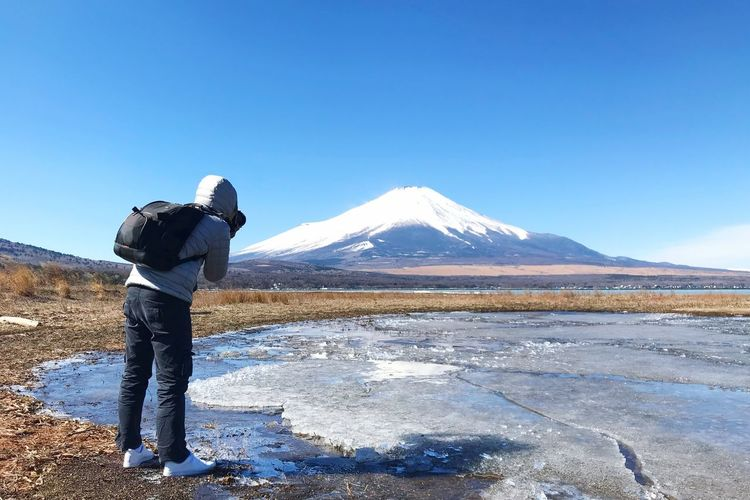 Mr. photographer Fuji Mountain Yamanaka Lake Japan Ice Lake Mountain Rear View Cold Temperature One Person Snow Mountain Range Real People Clear Sky Snowcapped Mountain Scenics Beauty In Nature Winter Sky Water