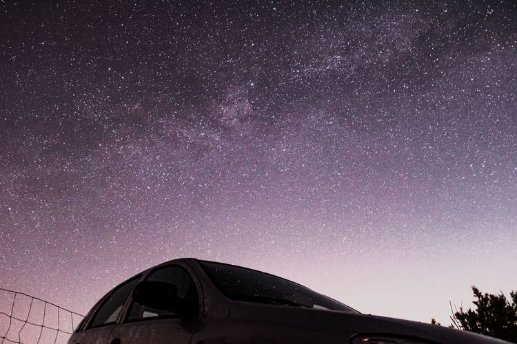Low angle view of car against sky at night
