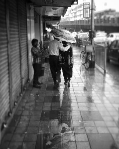 Monochrome Photography Full Length Walking Men Lifestyles Person Built Structure City Leisure Activity Casual Clothing Architecture Shopping Day Footpath Focus On Foreground City Life Retail