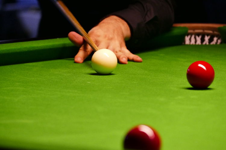 Cropped Hand Playing Pool