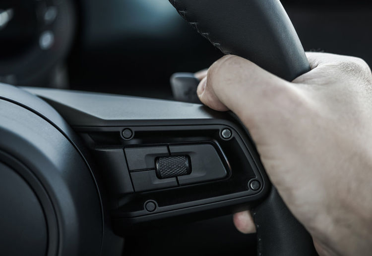 Close-up of hand holding car