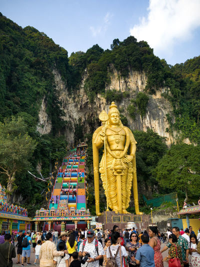 Leading up to Batu Caves EyeEmNewHere Temple Hindhuism Hindhu Temple Tree Statue Sculpture Men Religion Sky Pilgrimage Golden Color First Eyeem Photo