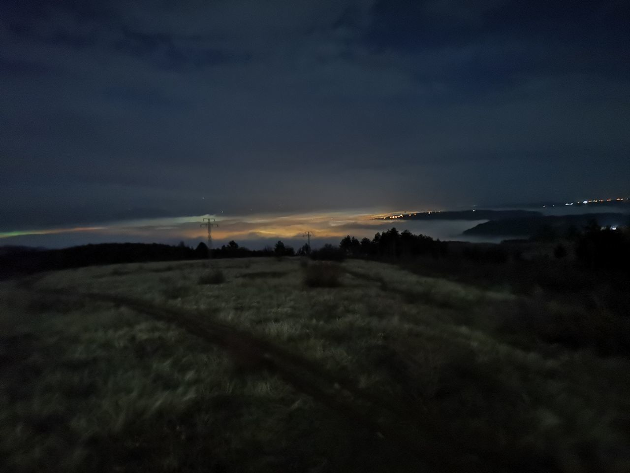 SCENIC VIEW OF LAND AGAINST SKY AT SUNSET