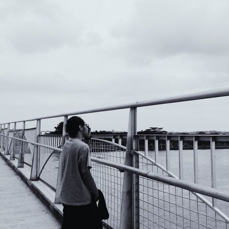 Bridge - Man Made Structure Sky Connection One Person Cloud - Sky Day Outdoors River Architecture Footbridge Bridge EyeEmNewHere
