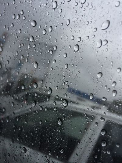 Raindrops on my car windshield . A perfect shot Created by nature