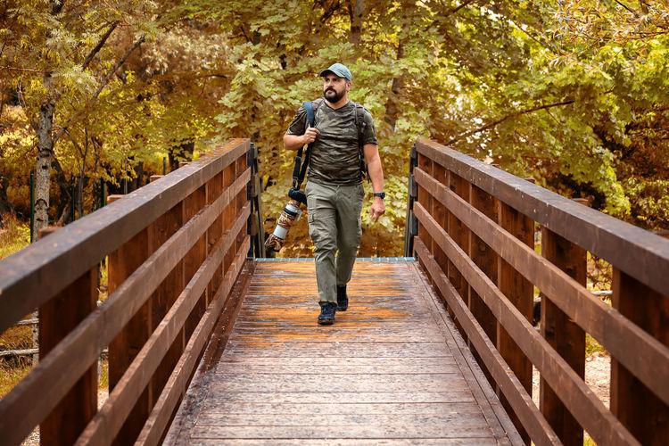 Full length of man walking on footbridge