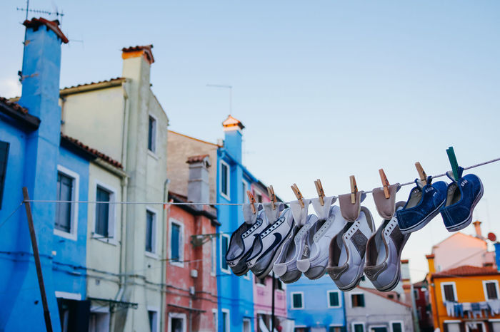 Drying shoes in Venezia Blue Burano Casual Casual Clothing Colorful Community Dry Drying Drying Clothes Drying Shoes Everyday Lives Gumshoes In A Row Life Lifestyle Lifestyles Multi Colored Pin Shoes Sneackers Venezia Wash Washing