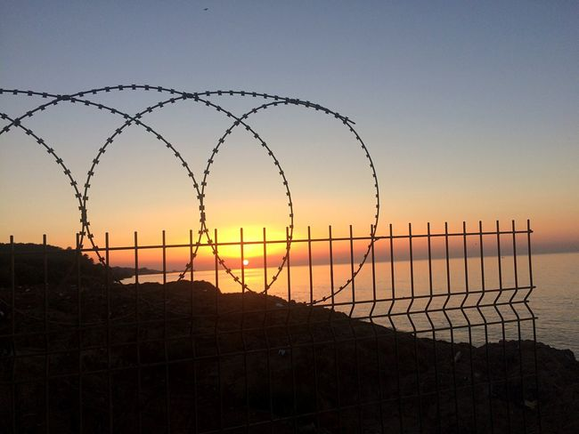 Protection Sunset Safety Security Razor Wire Outdoors City Like Followme Barbed Wire Nature Beauty In Nature No People Scenics Silhouette Sky Tranquility Grass Day
