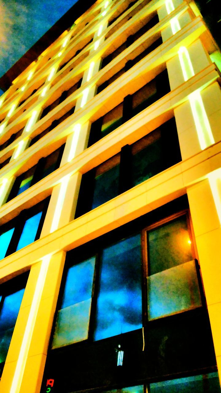 window, low angle view, no people, architecture, building exterior, built structure, yellow, outdoors, illuminated, day, sky, city, close-up