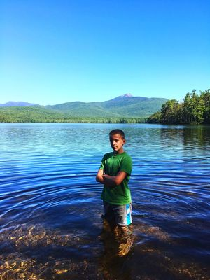 Blue Water Clear Sky Standing Copy Space Scenics Leisure Activity Lifestyles Lake Casual Clothing Mountain Person Beauty In Nature Vacations Tranquil Scene Mountain Range Nature Tranquility Non-urban Scene Shore Newtalent Strongboy Handsome Tween People And Places