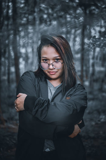 Portrait of beautiful young woman in forest