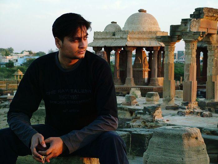 Young man visiting old ruins