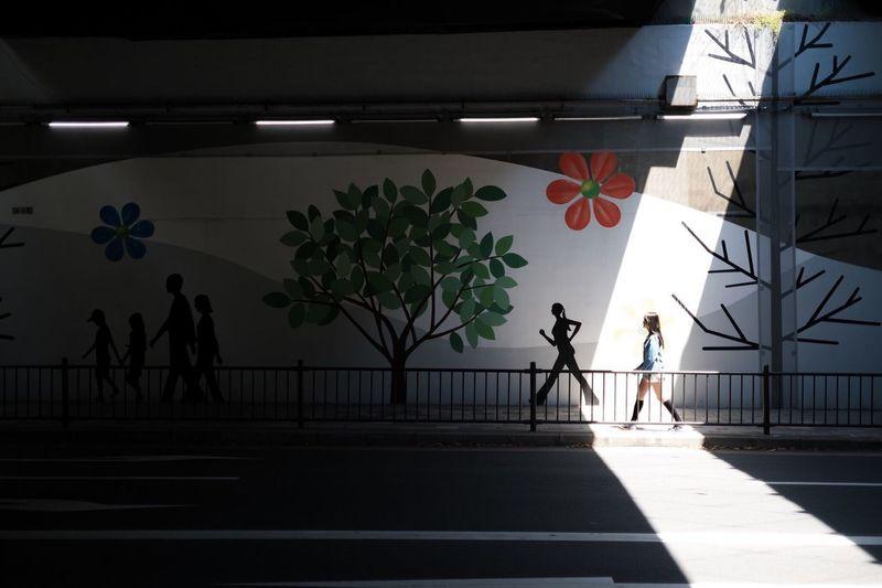 People standing on sidewalk in city