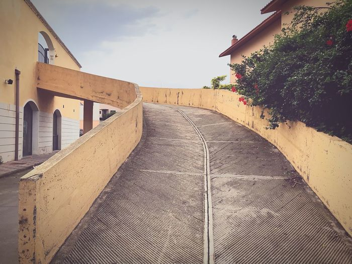 Skateboarding Texture Rough Ramp Driveway Garage Architecture Sky Built Structure Building Exterior Tree Nature Plant No People Building Low Angle View Sunlight Outdoors Pattern