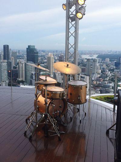Drum Set Against Cityscape