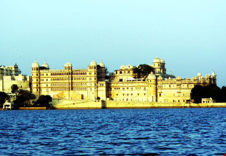 Miles Away Building Exterior Architecture Water Waterfront Built Structure City Clear Sky Outdoors No People Sky Day Lake Udaipurpalace Lakepichola Tourist Attraction  Rajasthandiaries Vacations Travel History