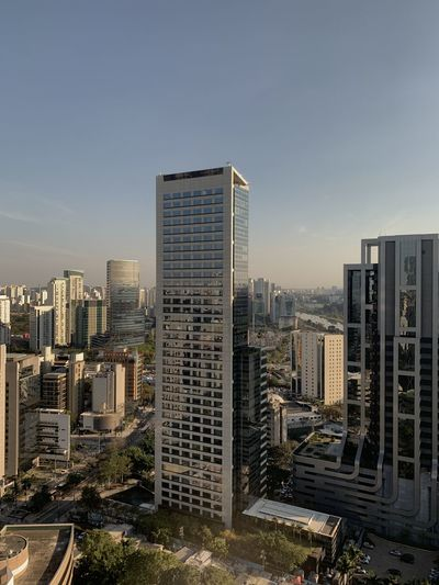 High angle view of buildings in city against sky