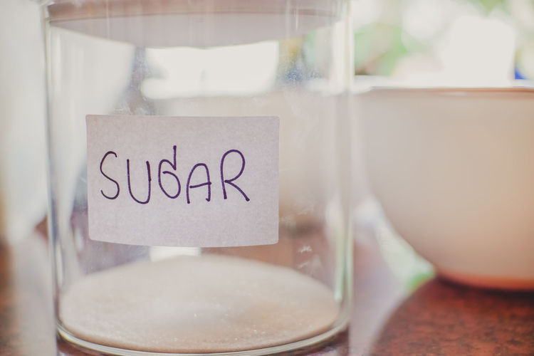 Suger in jar. Sugar Bakery Close-up Communication Cup Day Focus On Foreground Food And Drink Glass - Material Handwriting  Indoors  Information Jar Kitchen Message Mug No People Note - Message Sign Still Life Table Text Transparent Western Script White Window The Still Life Photographer - 2018 EyeEm Awards