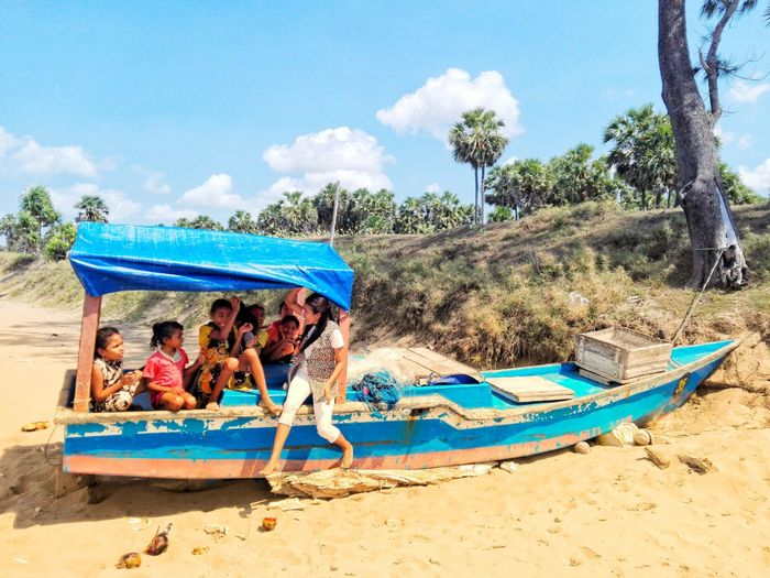 Friendship Beach Sand Happiness Summer Togetherness Cheerful Relaxation Fun Water Beach Umbrella Surfboard