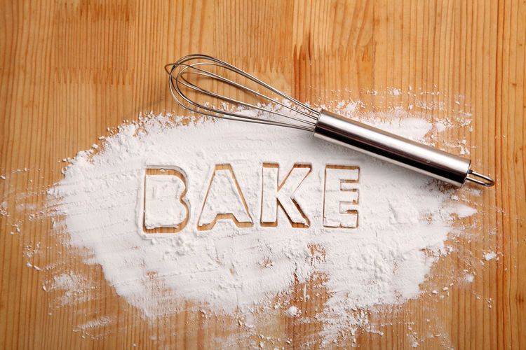 baking concept,flour on the wooden table with word BAKE Text Wood - Material Western Script No People Communication Indoors  Wood Close-up Table Sign Studio Shot Wood Grain Food Food And Drink Backgrounds Homemade Powder Flour Ingredient Bakery Hand Whisk Whisk