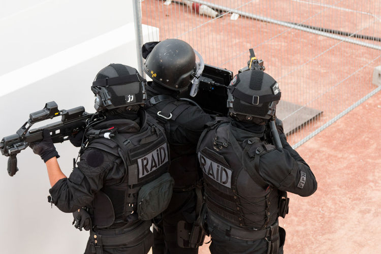 Police force standing with guns