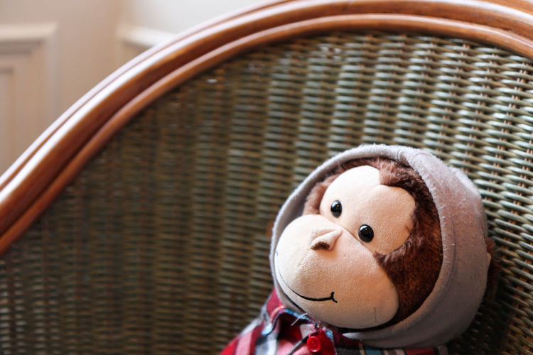Sitting Toy Monkey Chair Fun Toy Monkey Wicker Chair Art And Craft Brown Checked Shirt Cheerful Close-up Clothing Creativity Daylight Focus On Foreground Fun Hood - Clothing Hooded Indoors  Monkey No People Representation Selective Focus Smiling Smiling Face Stuffed Toy Toy