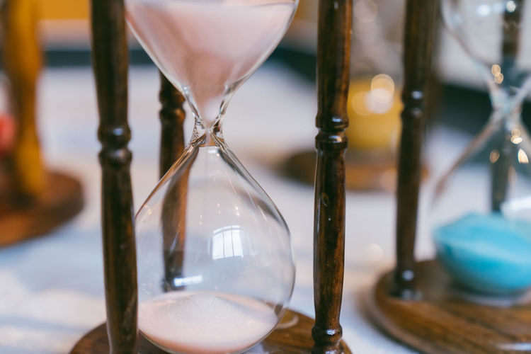 Close-up of hourglass on table