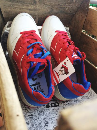 Out Of The Box In The Box Where's Wally? Red White And Blue Sneakers High Angle View Inside The Box Let's Go. Together. Fashion Stories