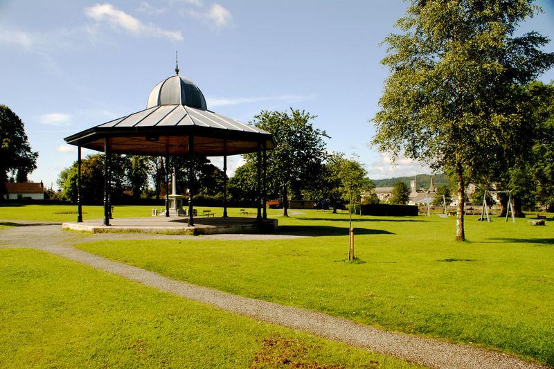 Gazebo in park against sky