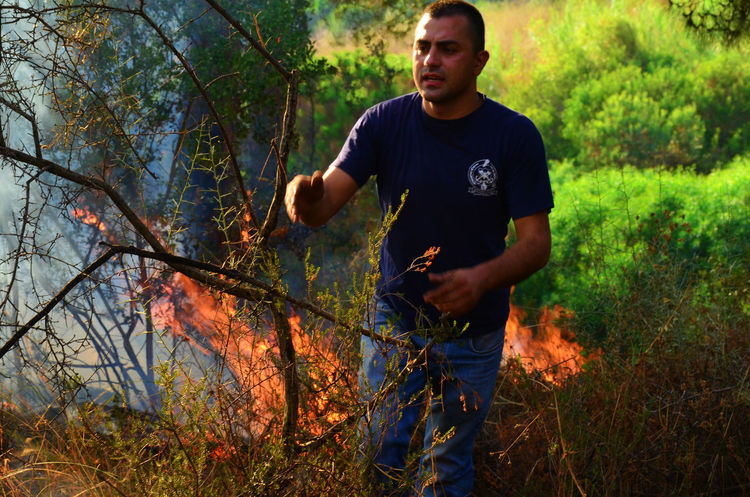 A fire broke out in a forest in Lebanon Disaster Fire Firefighter Firefighters Fireman Firemen Firemen At Work Forest Forest Fire Lebanon Natural Disaster Putting Out A Fire Smoke