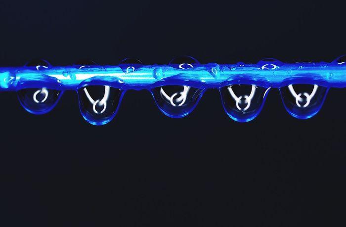 Blue Copy Space Black Background Studio Shot No People Illuminated Close-up Outdoors Raindrops Ringflash Washing-line Droplets
